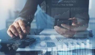 business-man-analysing-market-report-with-business-analytics-dashboard-virtual-screen_158043-52